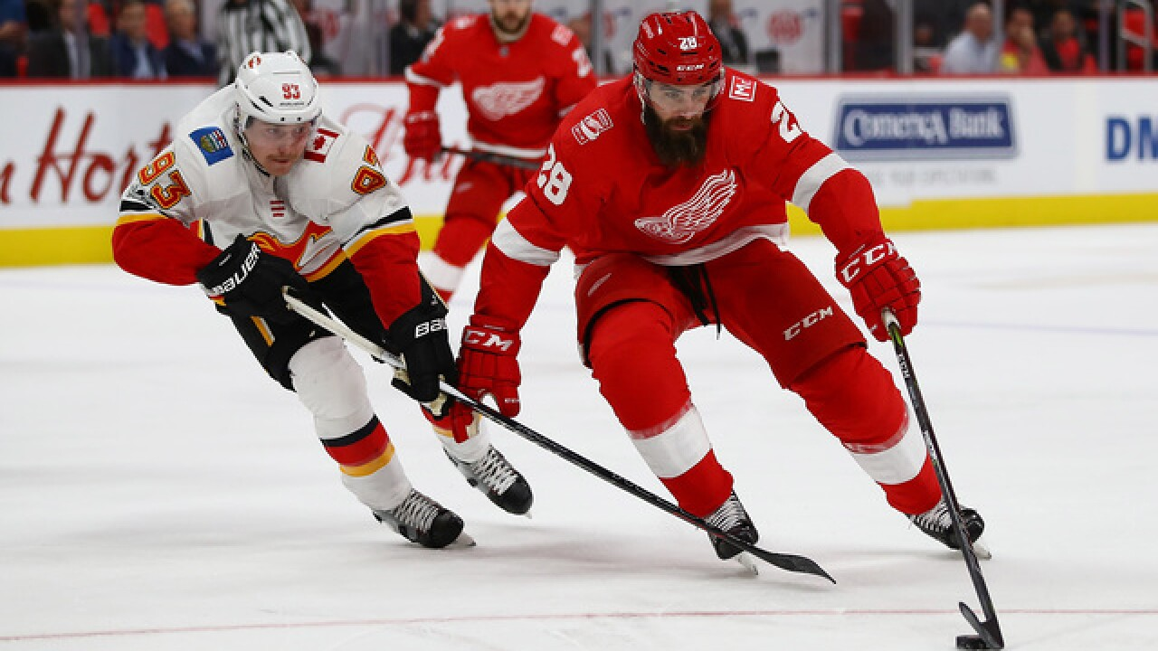Mantha, Athanasiou lead Red Wings to 8-2 win over Flames