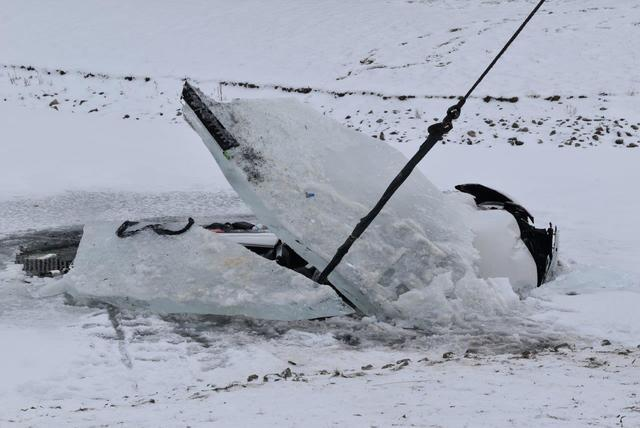 PHOTOS: Car removed from frozen pond by Indy firefighters