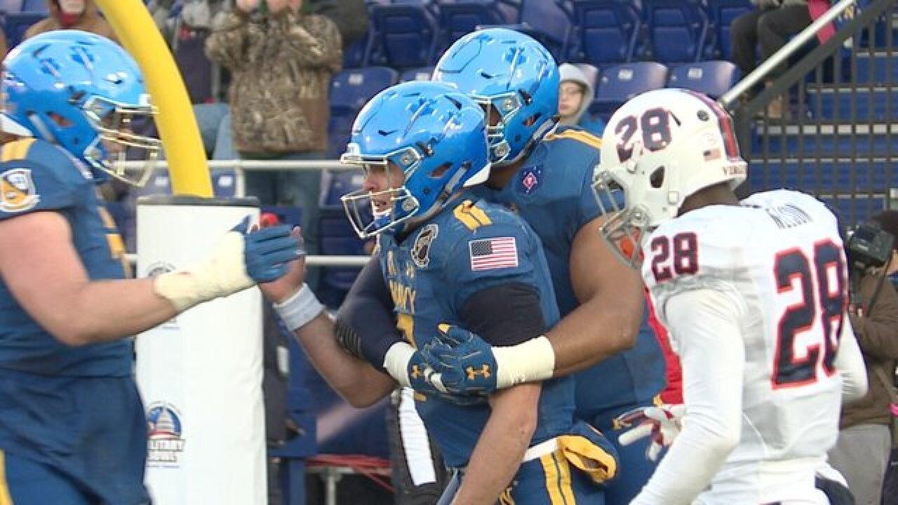 Navy beats Virginia 49-7 in Military Bowl
