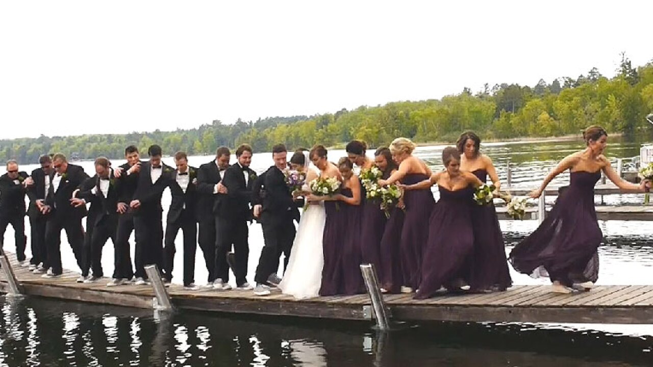 Watch: Wedding party regrets posing for photo on dock