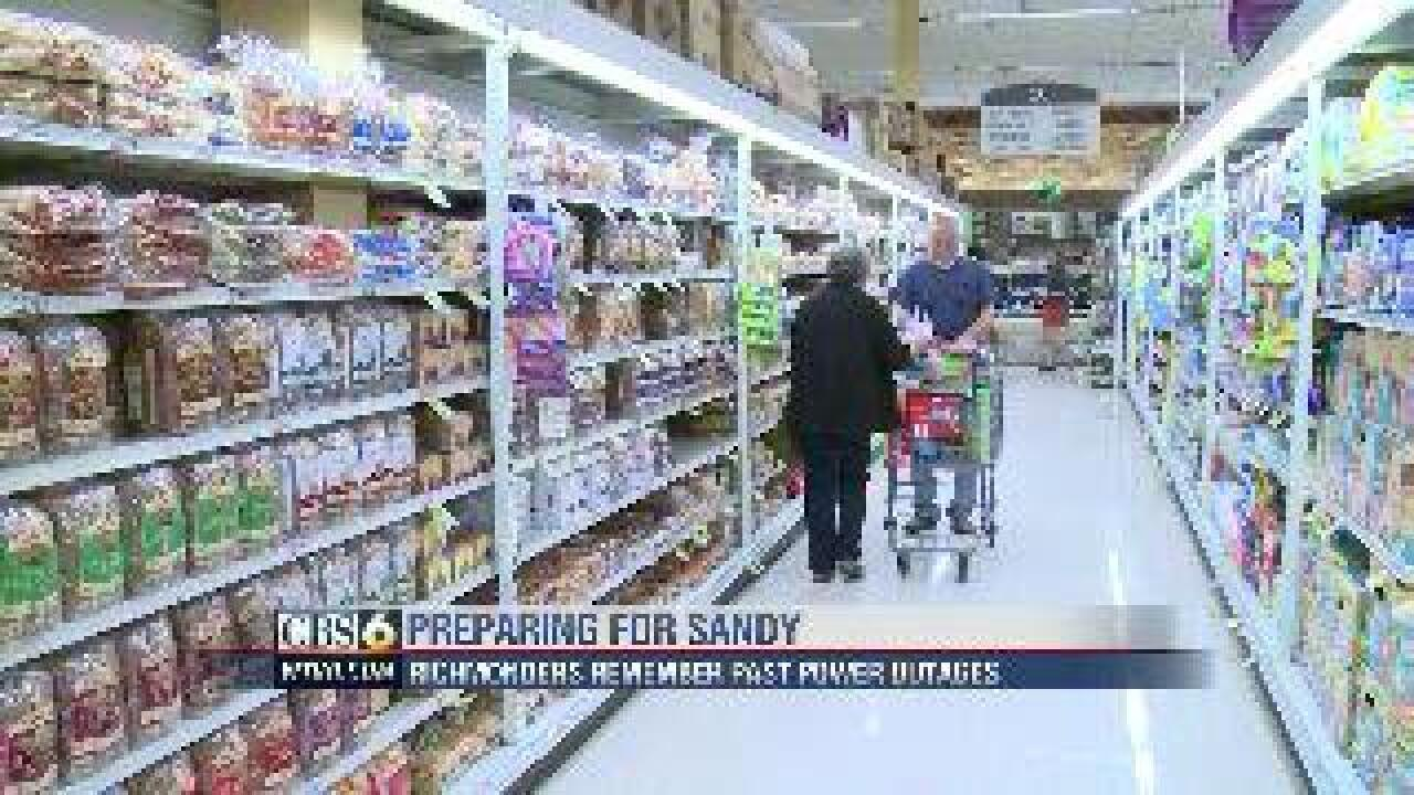 Grocery Store Madhouse: Folks stock up for Hurricane Sandy
