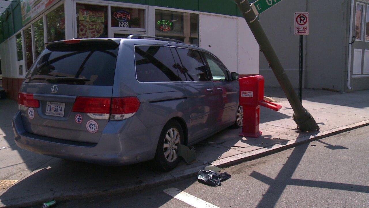 Minivan hits pole, nearly crashes into Richmondpizzeria