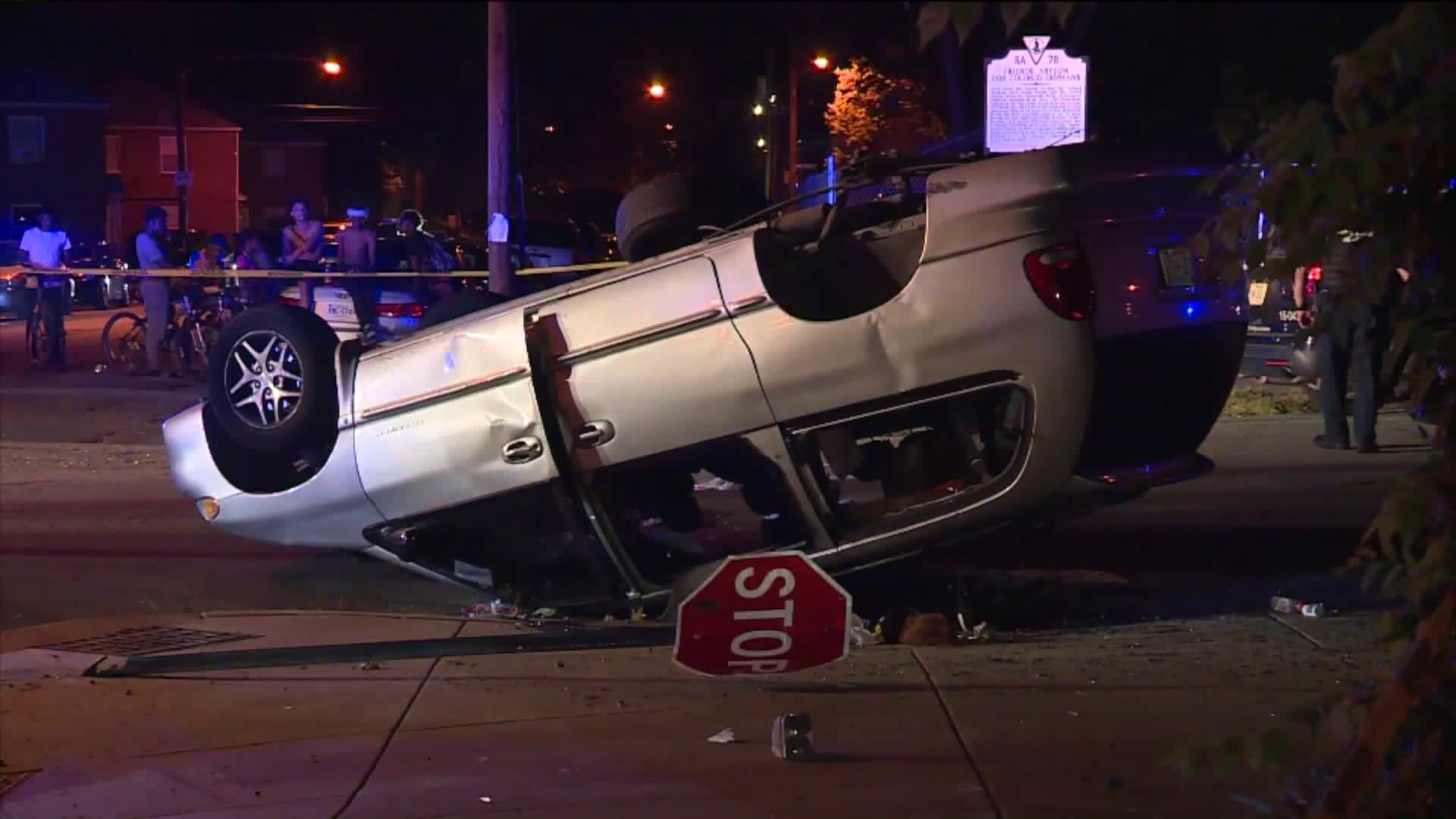 Photos: Car overturns after collision with Richmond Police cruiser