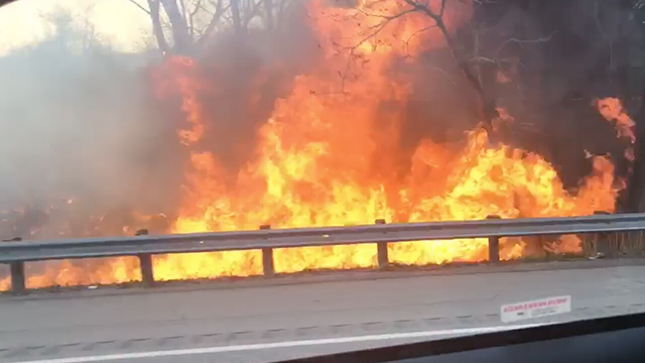 Fire on the side of I-71 South near W. 130th