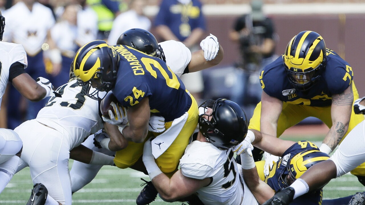 No  7 Michigan holds on to beat Army in double overtime
