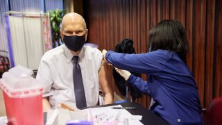 President Russell M. Nelson of The Church of Jesus Christ of Latter-day Saints receives his first dose of a COVID-19 vaccine.