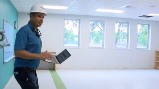 Principal Joshua Davidow shows the inside of a classroom at the rebuilt Addison Mizner K-8 School in Boca Raton on June 15, 2021.jpg