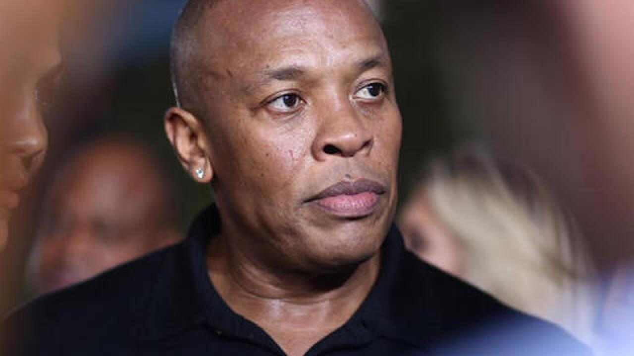 Dr. Dre cited on gun charge after driveway encounter