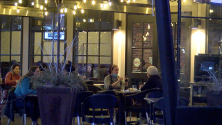 People eating on outside patio in Downtown Indianapolis