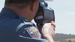 State trooper clocking with radar