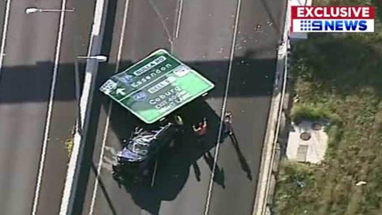 wptv-road-sign-falls-onto-vehicle.jpg
