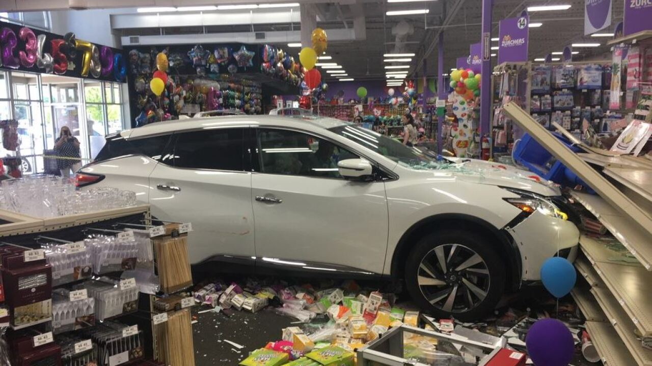 Car crashes through front of party supply store in Orem