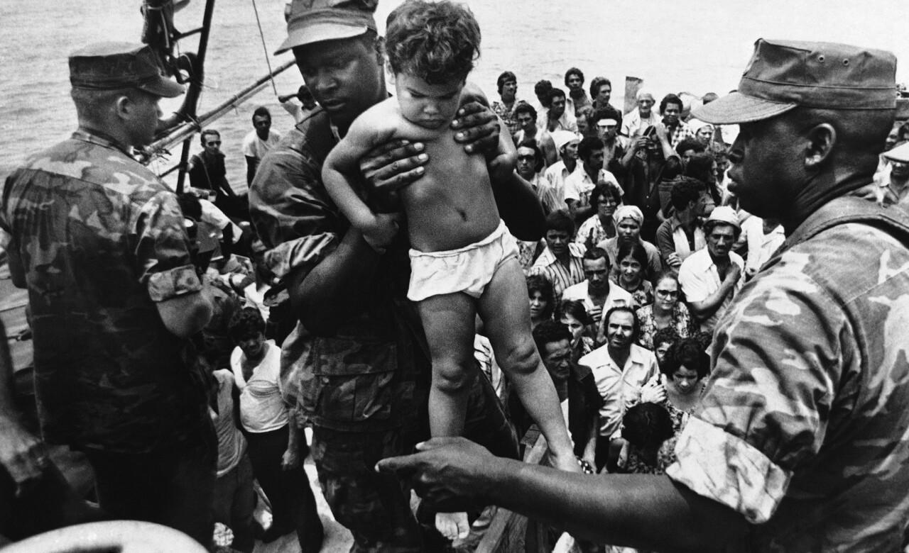 U.S. Marine helps child off refugee boat during 1980 Mariel boatlift in Key West