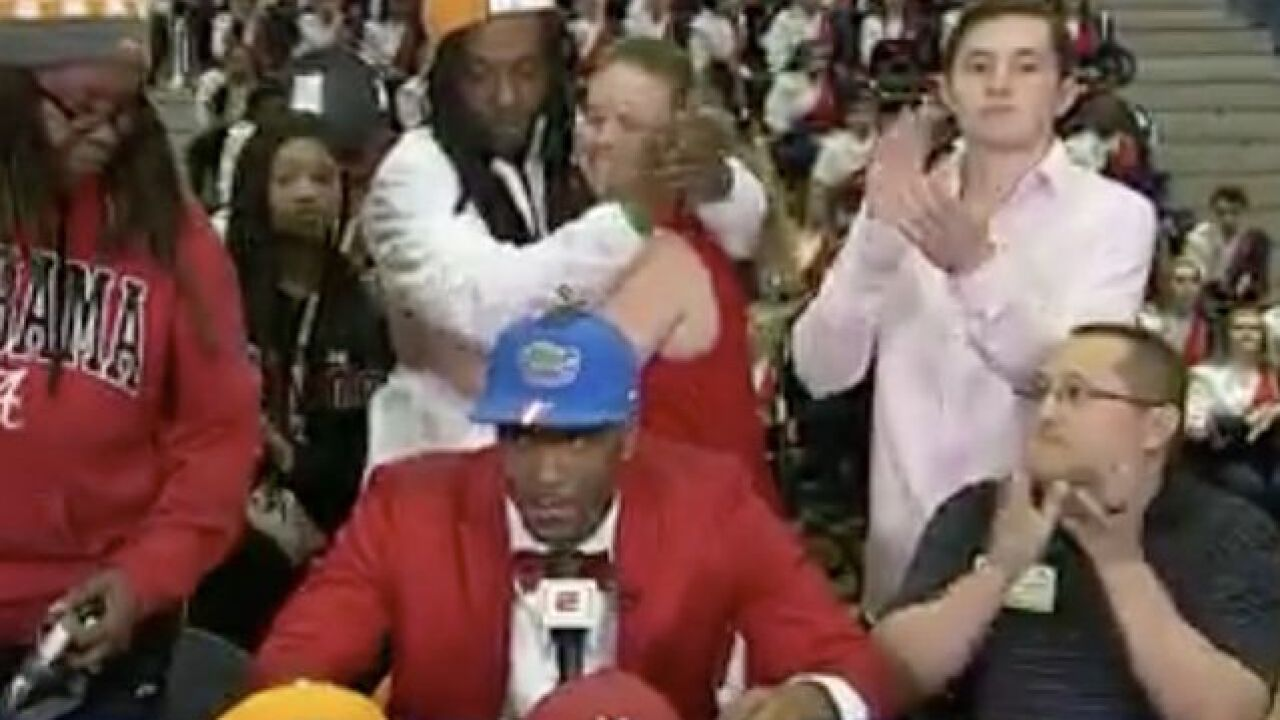VIDEO: Recruit's mom walks off stage after he chooses Florida on signing day