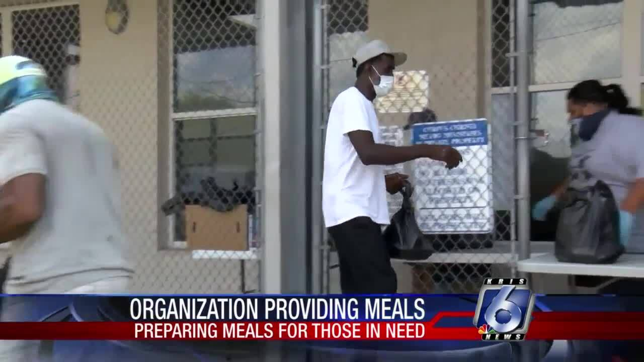 Local volunteers provide meals for homeless