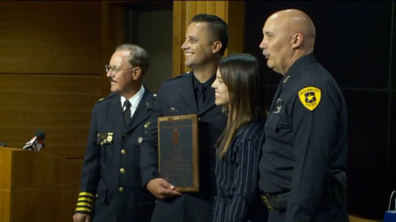 Salt Lake City cop honored for rescuing sisters from armed attacker