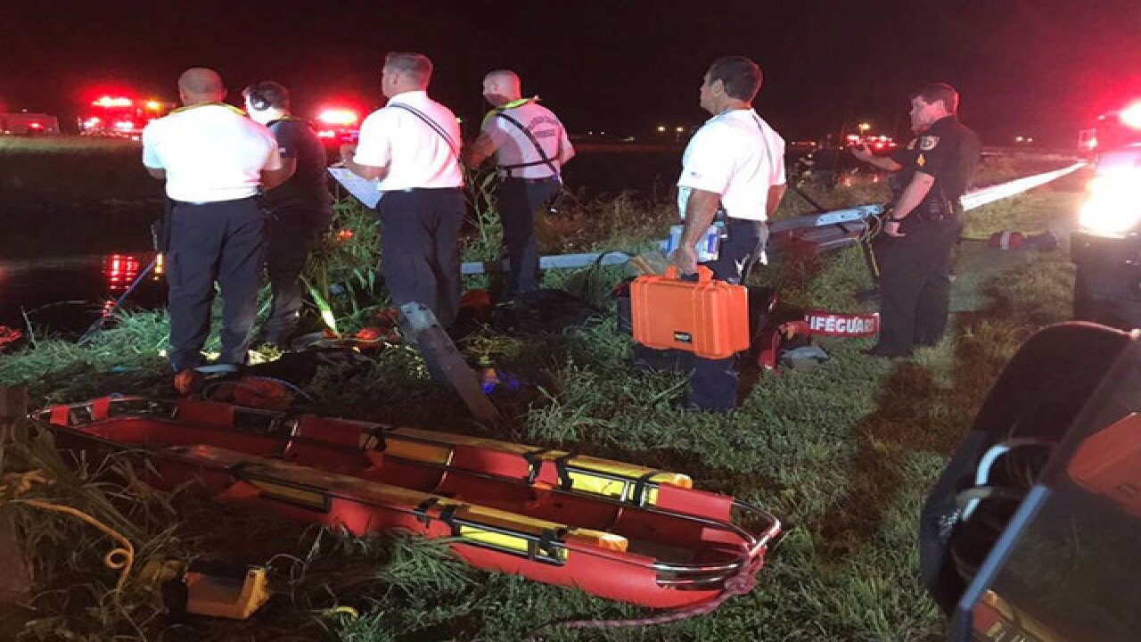 2 saved from crash in gator-infested canal
