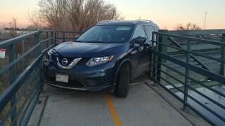 Car stuck on S Platte River Trail