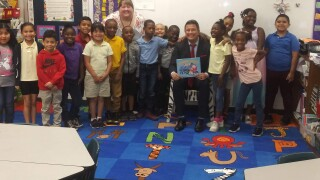 WPTV Newschannel 5 anchor Mike Trim read to a group of second graders at the Wynnebrook Elementary School in central Palm Beach County on Thursday.