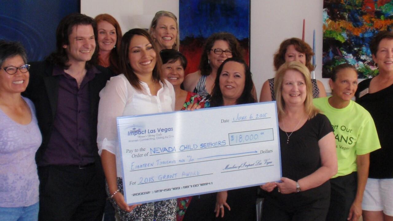 6-7-2015 Impact Las Vegas Members Present Grant Check to Nevada Child Seekers.JPG