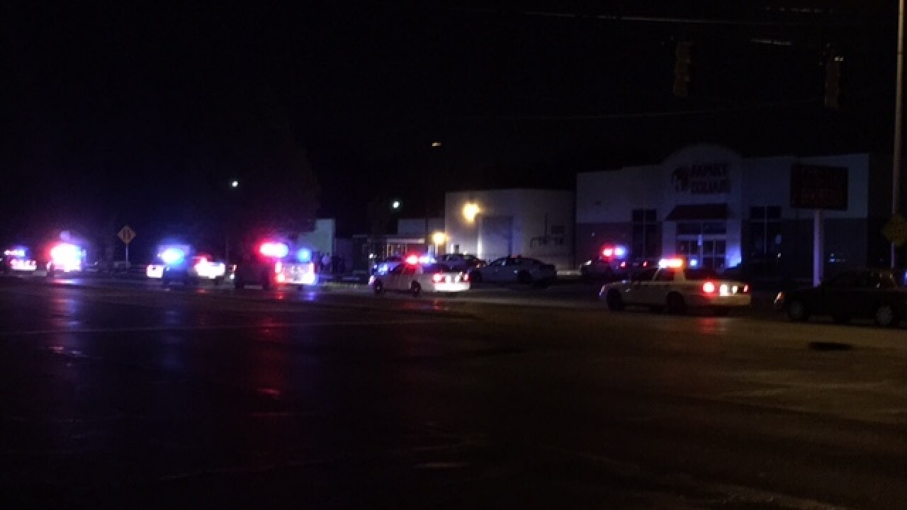 IMPD officer fires shots, 2 people in custody
