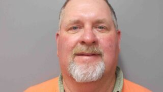 Crawfish farmer accused of attempting to run people over catching crawfish in roadside ditch