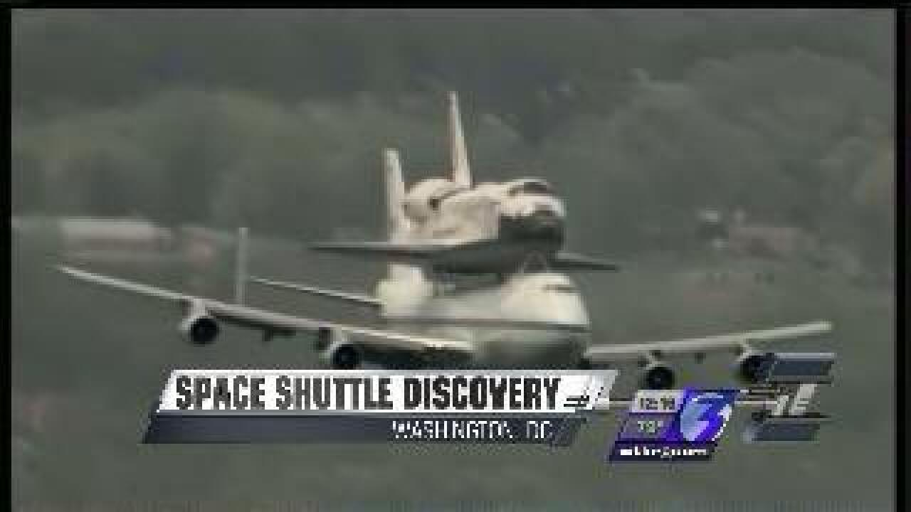 Space Shuttle Discovery reaches its final destination