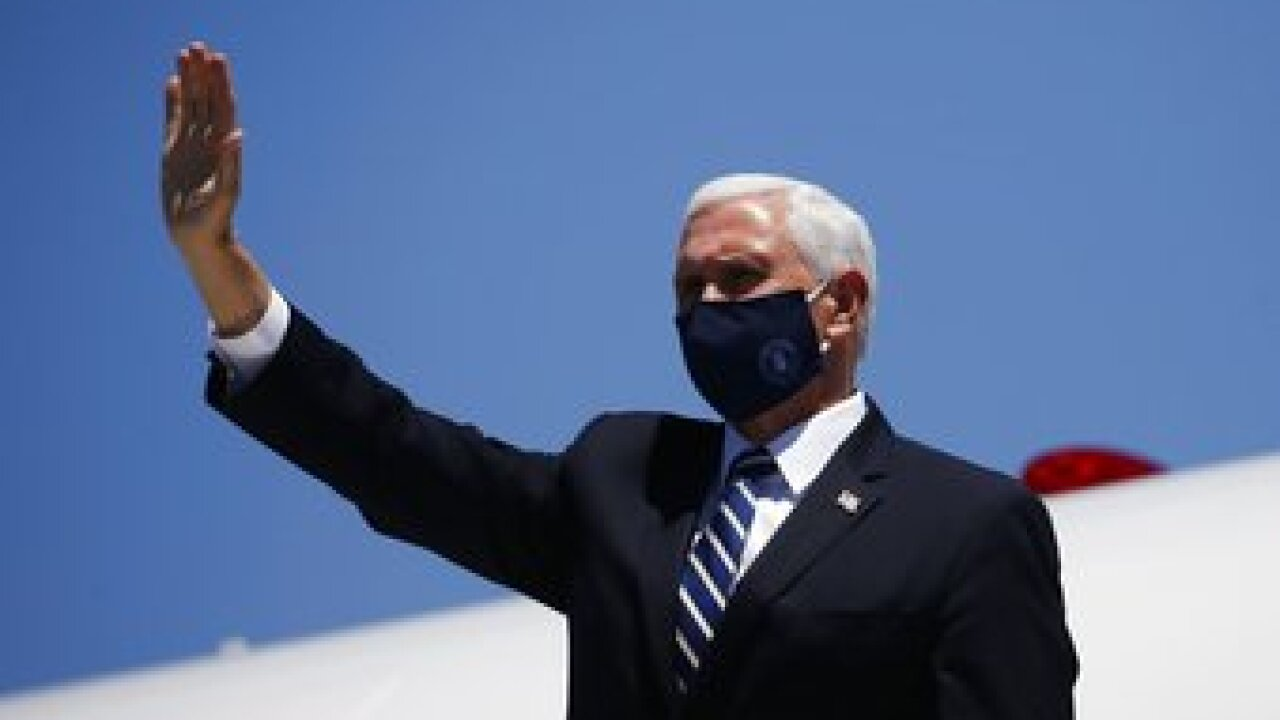 A masked Vice President Mike Pence arrived in Arizona as the state broke its own records with skyrocketing coronavirus cases and hospitalizations. Photo/AP.