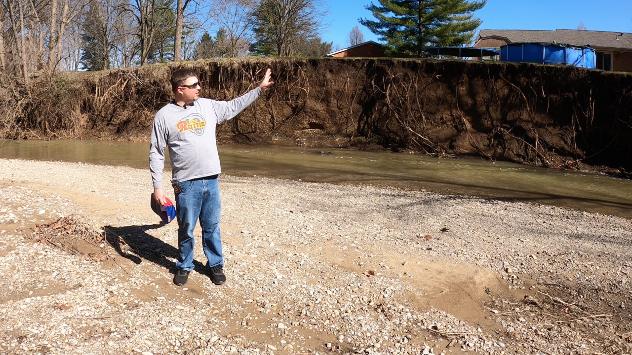 Jeremy Vowell shows section of his property eroded by Dry Run Creek in Ross Township.png