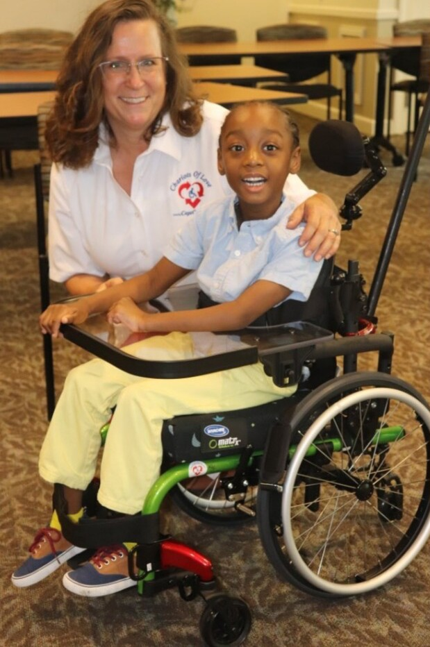 Valerie Mathieu poses with 'Chariots of Love' recipient