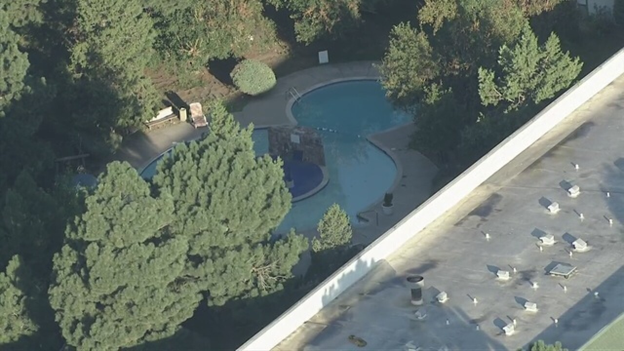 Mom arrested after 7-year-old drowns in pool
