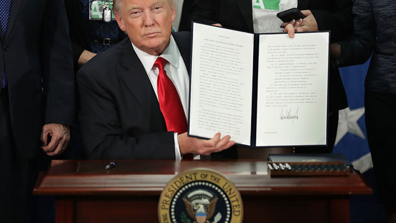 Donald Trump signs executive order to keep terrorists out of US