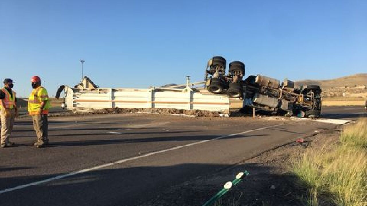Semi rolls over after blowing tire_chicken manure on street