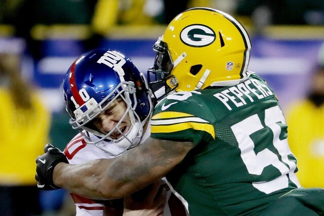 Former Packers player Julius Peppers, sacking Giants QB Eli Manning, announced his retirement