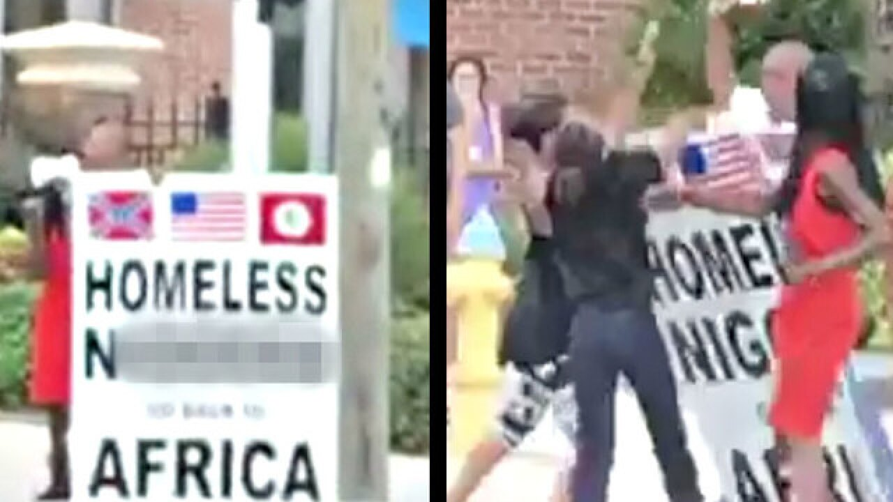 Tampa man holding sign with racial slur charged with attack using a deadly weapon