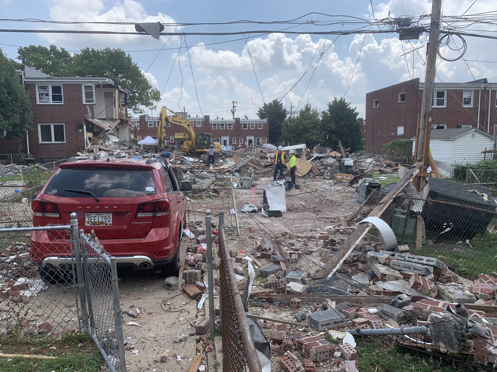 Two dead, others rescued after explosion demolishes homes in NW Baltimore.jpg