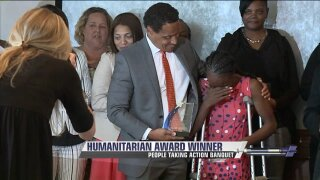 Portsmouth teacher battling cancer wins People Taking Action Humanitarian Award