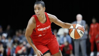 Basketball star stepping back to focus on social justice, shoe brand will pay forfeited salary