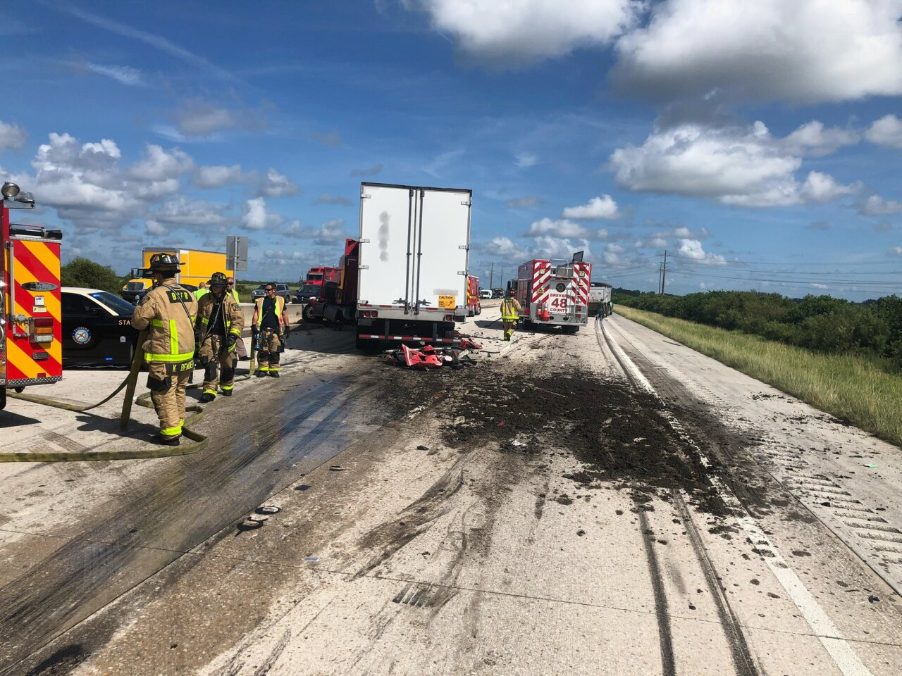 A crash involving a tractor trailer and a dump truck left cow manure over a portion of Interstate 95.