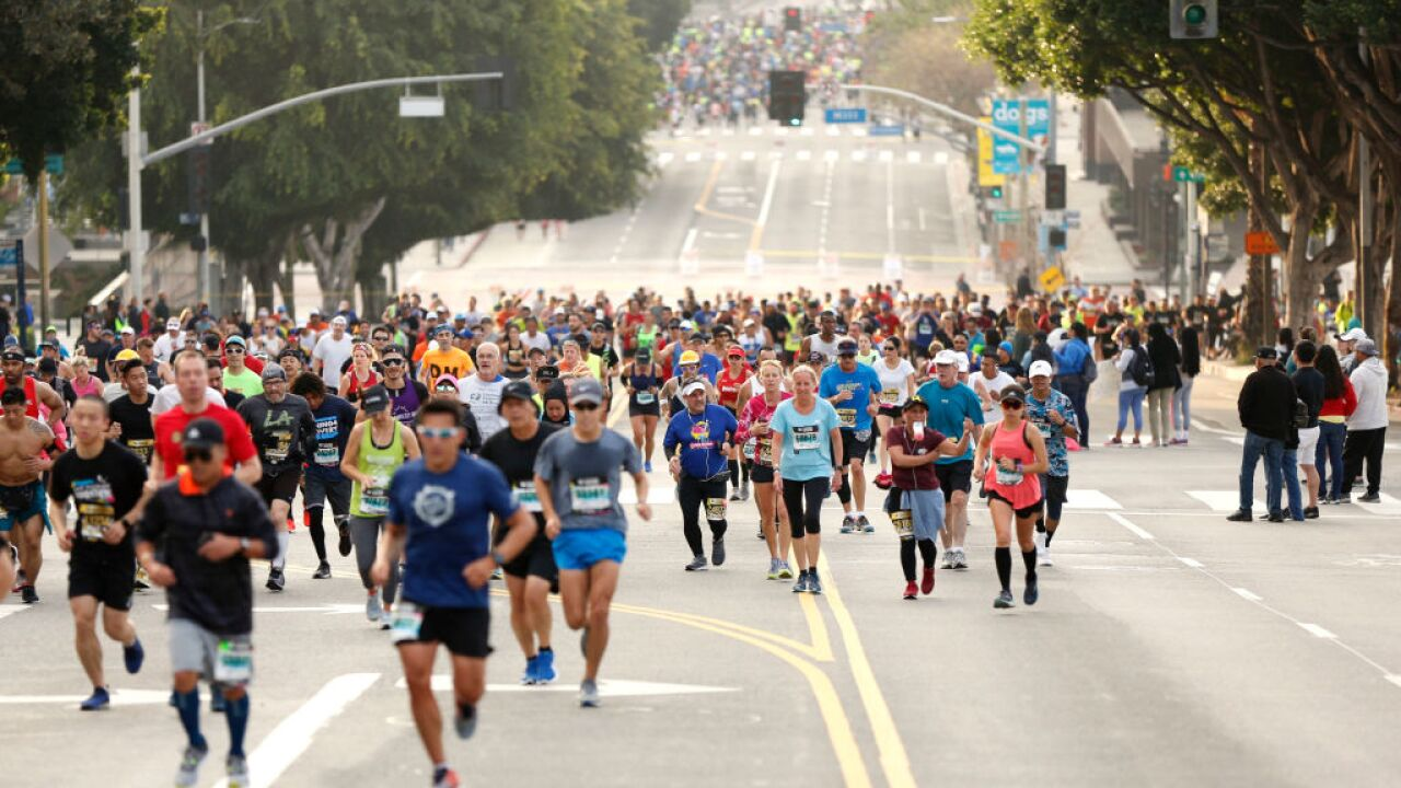 A marathoner accused of cheating after clocking a record time dies by suicide