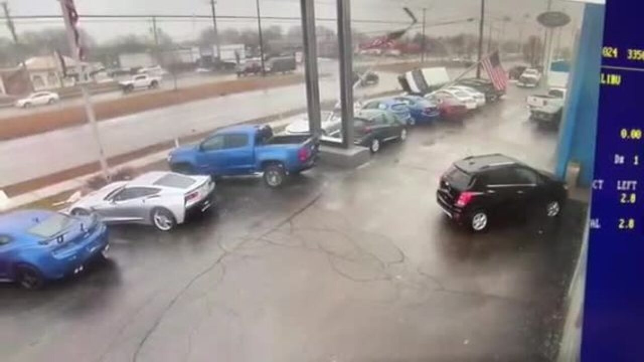 Video Van Strikes Multiples Poles That Fall On Vehicles At