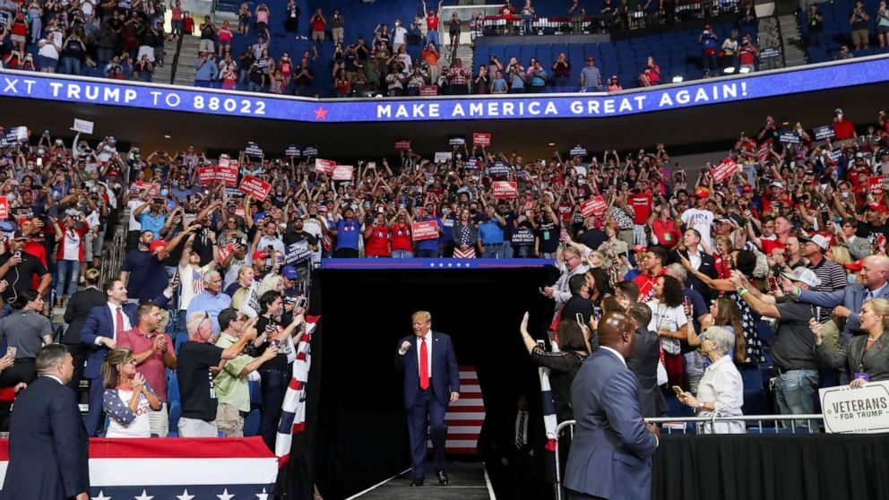 President Donald Trump pumps his fist as he enters his first re-election campaign rally in several months in the midst of the coronavirus disease (COVID-19) outbreak, at the BOK Center in Tulsa, Oklahoma, June 20, 2020.