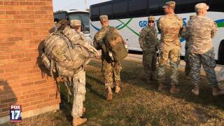 Michigan National Guard members await transportation
