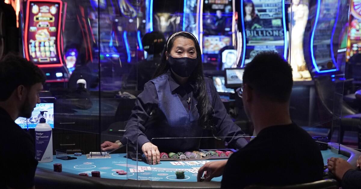 Some Las Vegas casinos limit smoking at table games