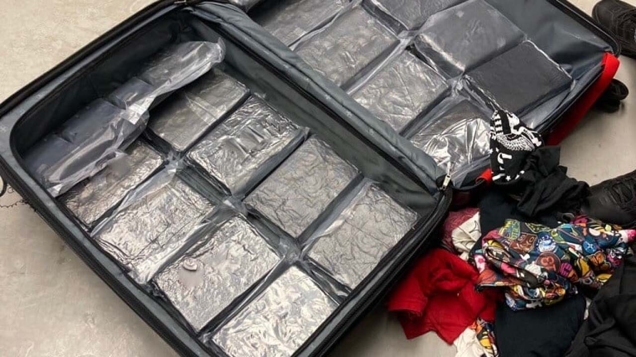 Pima County Sheriff's deputies arrested a woman who was allegedly carrying a suitcase containing nearly 50 pounds of cocaine Wednesday.