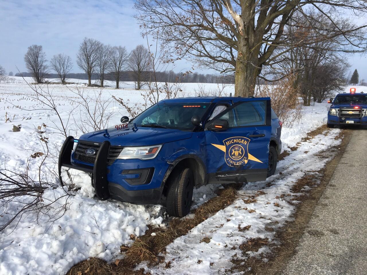 Michigan State Police Vehicle in a ditch