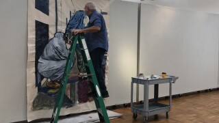 """The exhibition of paintings titled """"We're All Wearing Masks Now"""" will open to the public on Friday."""