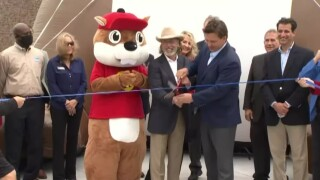 Florida Gov. Ron DeSantis attends a ribbing cutting event at a Buc-ee's gas station and convenience store in Daytona Beach on March 22, 2021