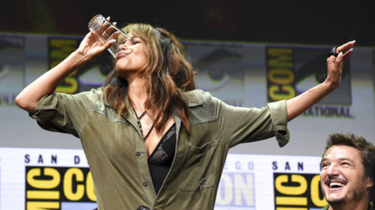 Halle Berry downs a half pint of whiskey at Comic-Con panel