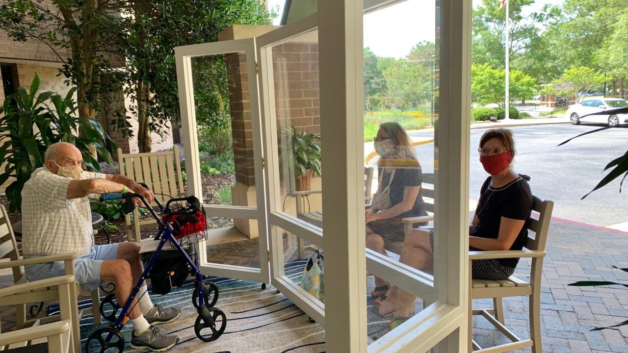 Families can schedule a block of time to visit their loved ones through a plexiglass partition outside of the Hoy Center at Westminster-Canterbury on Chesapeake Bay.
